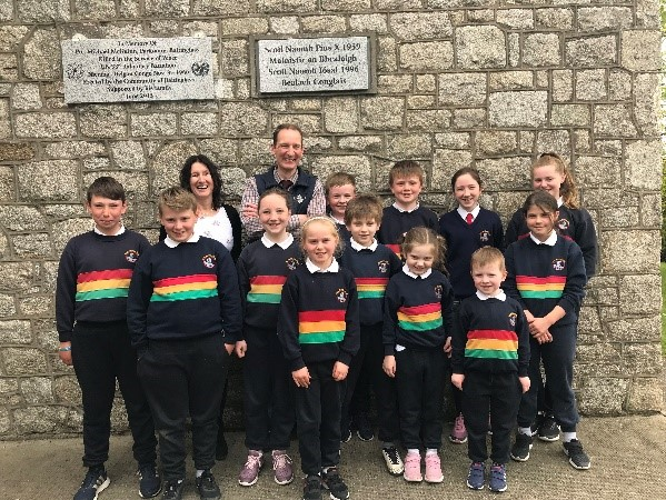 Here are the junior Pattersons and their second cousins who attend Scoil Naomh Iosaf, pictured with Derek and the Principal Ms Hennessy.